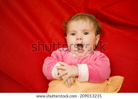 young baby singing, studio picture - stock photo