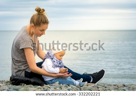 Young Babysitter Hold Cute Little Baby Stock Photo (Royalty Free ...