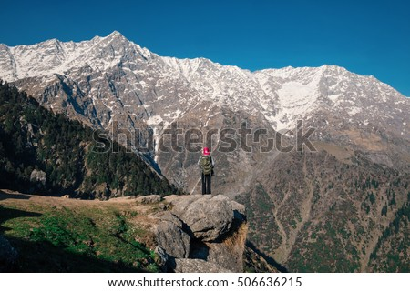 Young backpacker standing in front of the first peaks of the Himalaya, India