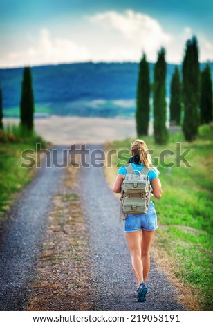 Young backpacker traveling along Europe, happy female walking in the park, discovering world, summer vacation concept - stock photo