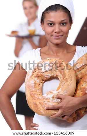 Young baker and waitress - stock photo