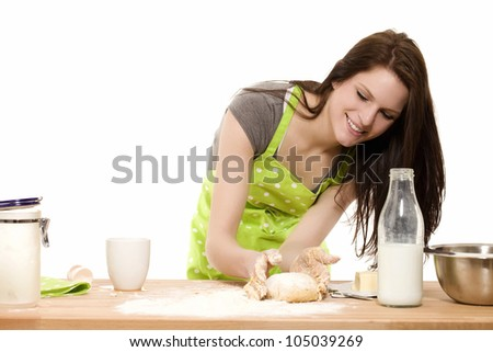 young baking woman forming dough with her hands on white background - stock photo