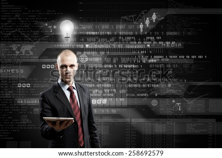 Young bald businessman with tablet pc against digital background - stock photo