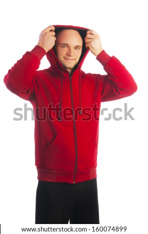 Young bald man in sport red jacket with zipper taking off the hood isolated on white background - stock photo