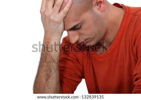 Young bald man suffering from stress - stock photo