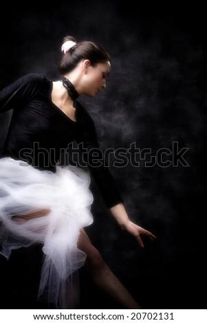 young ballerina practicing, studio shot - stock photo