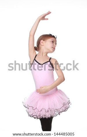 Young ballerina wearing lovely tutu dancing like a swangirl isolated over white background - stock photo
