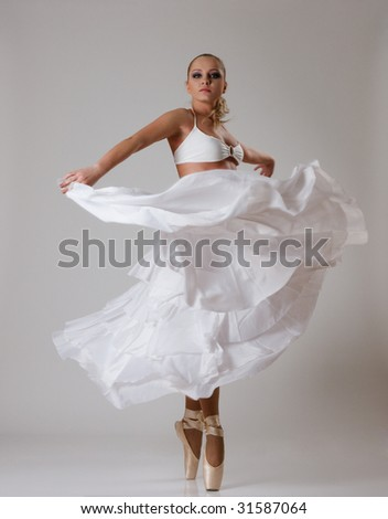 Young ballet dancer in white ballet-dress - stock photo