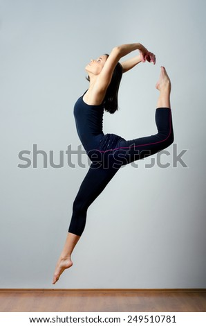 Young ballet dancer jumping high in the air. - stock photo