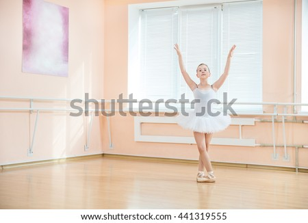 Young ballet dancing student at a class