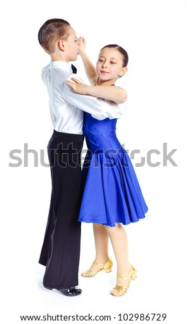 Young ballroom dancers in formal costumes posing. Isolated on white background