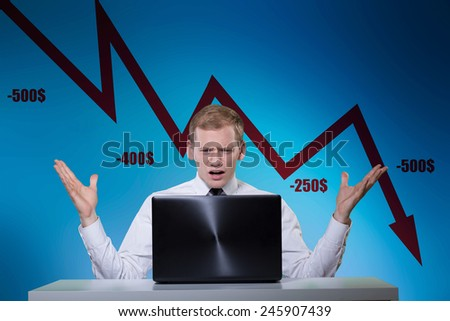 Young banker losing money because of market crisis - stock photo