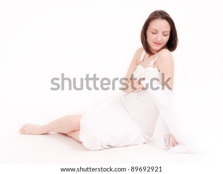 young barefoot amusing beauty in white dress