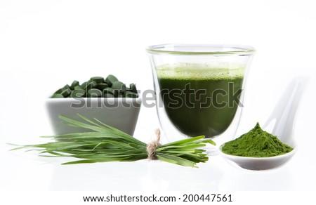 Young barley and chlorella spirulina. Detox superfood. - stock photo