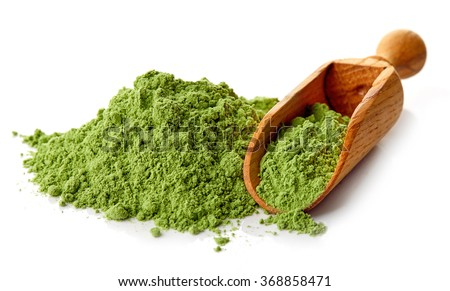 Young barley or wheat grass with wodden shovel, detox superfood, white background - stock photo