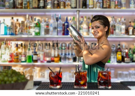Young barmaid inside Be Towers bar in Budrio, Bologna, Italy. This is the most famous bar in Budrio and young people came from all over the city to its parties. - stock photo