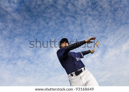 young baseball player taking a swing - stock photo