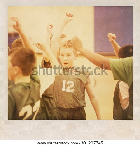 Young basketball player cheering with his team.  Vintage grunge  - stock photo