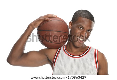 Young basketball player holding the ball isolated on a white background - stock photo