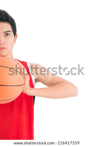 Young basketball player ready to throw the ball - stock photo