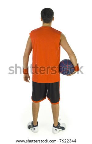 Young basketball player standing backwards. He holding basketball in hand. Isolated on white background, rear view.