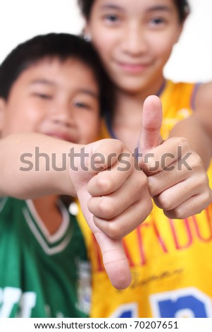 young basketball players making hands sign, focus on the hand - stock photo