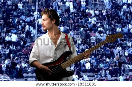young bass guitar  player in concert - stock photo