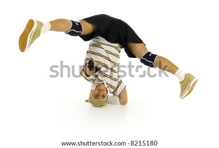 Young bboy holding up on hand and head. Holding legs in air. Looking and pointing at camera. Isolated on white in studio. Front view, whole body - stock photo