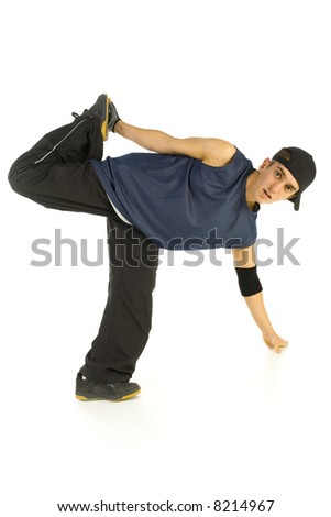 Young bboy holding up on hand and standing on one leg. Looking at camera. Isolated on white in studio. Front view, whole body - stock photo