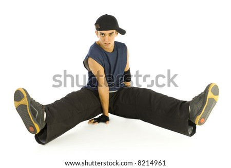 Young bboy holding up on hands. Holding legs in air. Looking at camera. Isolated on white in studio. Front view, whole body - stock photo