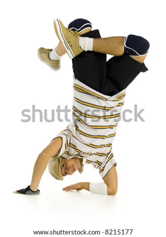 Young bboy standing on hands. Holding legs in air. Looking at camera and smiling. Isolated on white in studio. Front view, whole body - stock photo