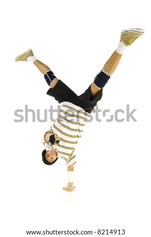 Young bboy standing on one hand. Holding legs in air. Looking and pointing at camera. Isolated on white in studio. Front view, whole body - stock photo