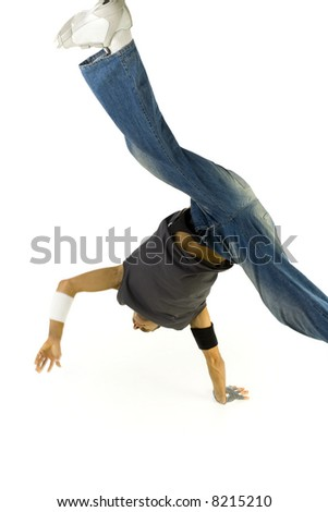 Young bboy standing on one hand with legs astride in air. White background - stock photo