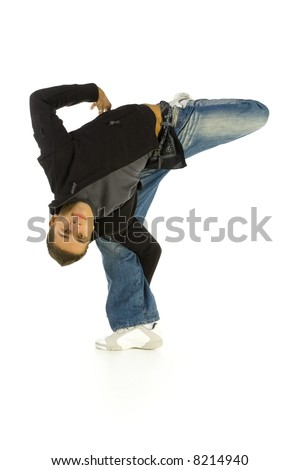Young bboy standing on one leg and holding lower part of it. Smiling and looking at camera. Isolated on white in studio. Front view, whole body - stock photo