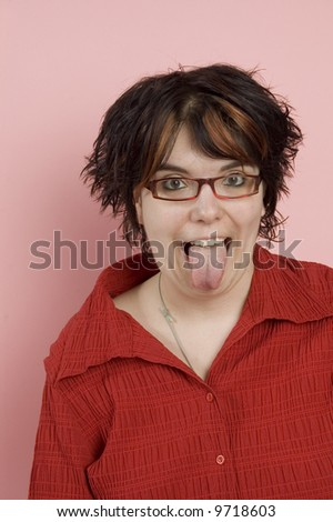 young beaitful woman sticking out tongue - stock photo
