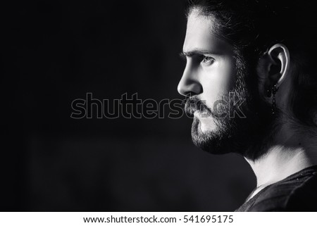young bearded hipster man. facial profile.