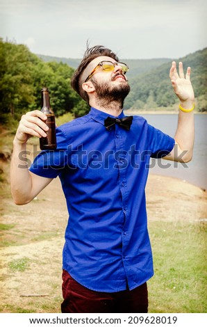 Young bearded hipster man looking happy