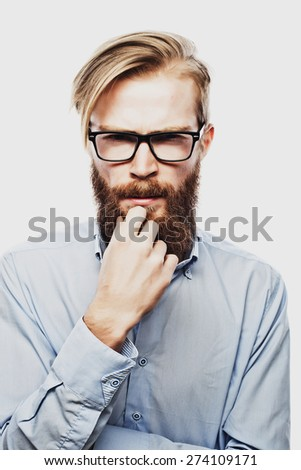 Young bearded hipster man wearing eyeglasses. Over white background. - stock photo