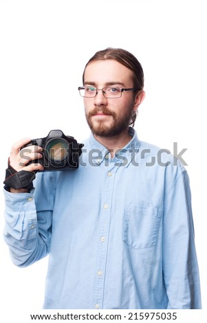 Young bearded man in blue shirt taking picture with camera  isolated on white