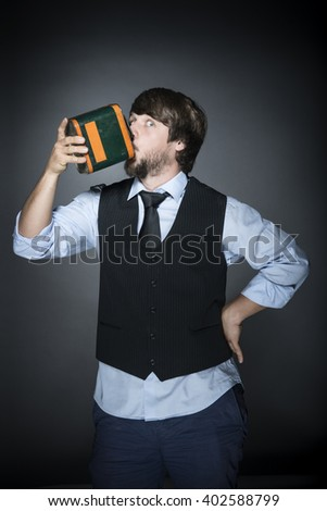 Young bearded man in studio with old oil can