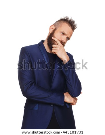 Young bearded man isolated at white background. Portrait of guy with beard thoughtful, pensive, charming and smiling, looking serious, upset. Problem solving, finding solution - stock photo