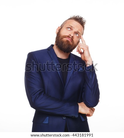 Young bearded man isolated at white background. Portrait of guy with beard thoughtful, pensive, charming and smiling, looking up. Trendy hipster think of problem solving, finding solution - stock photo