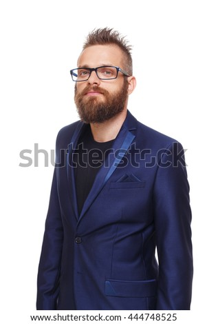 Young bearded man isolated at white. Portrait of a confident guy with beard looking at camera. Boy style, trendy hipster in glasses with cool hairstyle in blue suit. Modern businessman. - stock photo