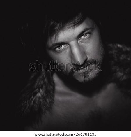 young bearded man posing - stock photo
