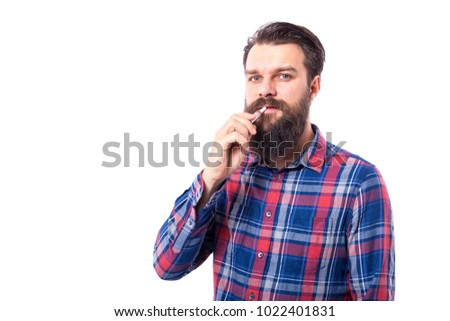 Young bearded man smoking electronic cigarette on white background