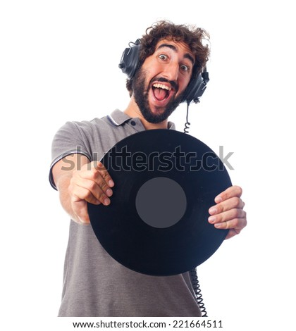 young bearded man with headphones and disk - stock photo