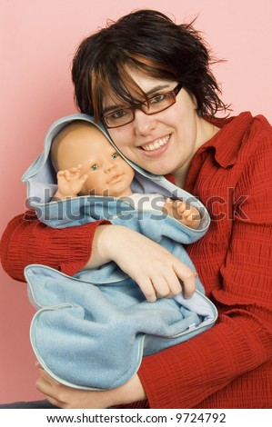 young beatiful woman holding a little baby-doll - stock photo