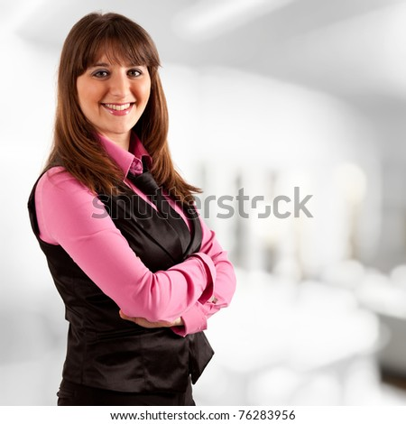 Young beauiful businesswoman in her office - stock photo