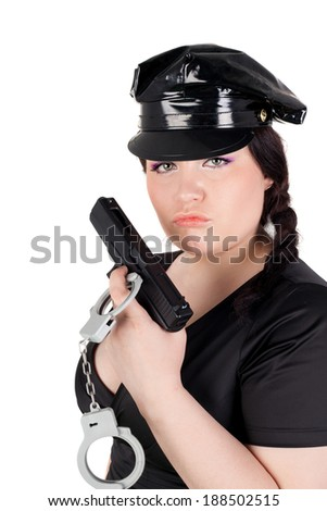 young beautifl police woman with the gun and handcuffs - stock photo