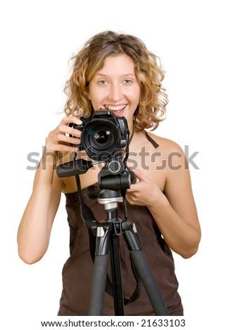 Young beautifu woman holding a photo camera - stock photo